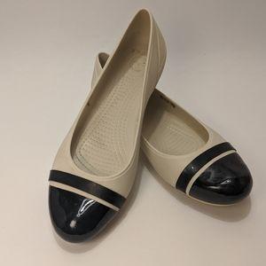 Crocs black & white flats size 9